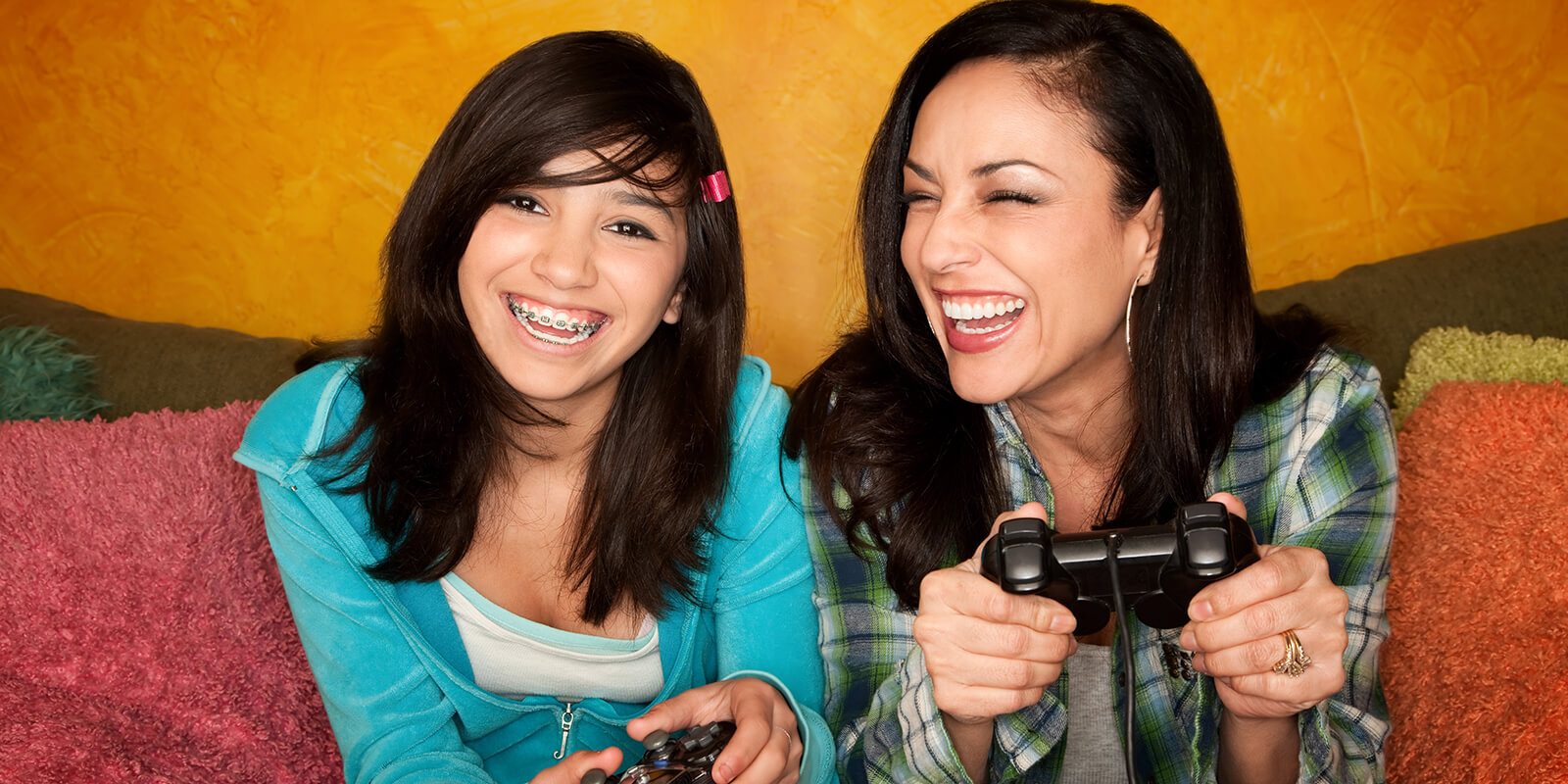 Mom and Daughter with Braces Playing Games